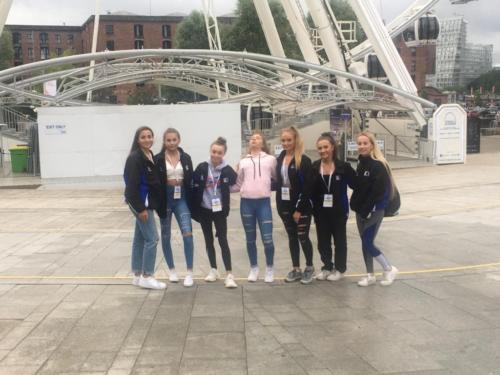 Gymnasts in front of Wheel of Liverpool
